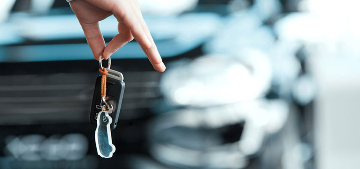 car keys and a car Steps to Take When Selling Your Car