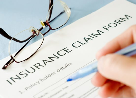 filling out an insurance claim form