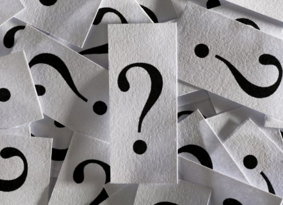 question marks on paper