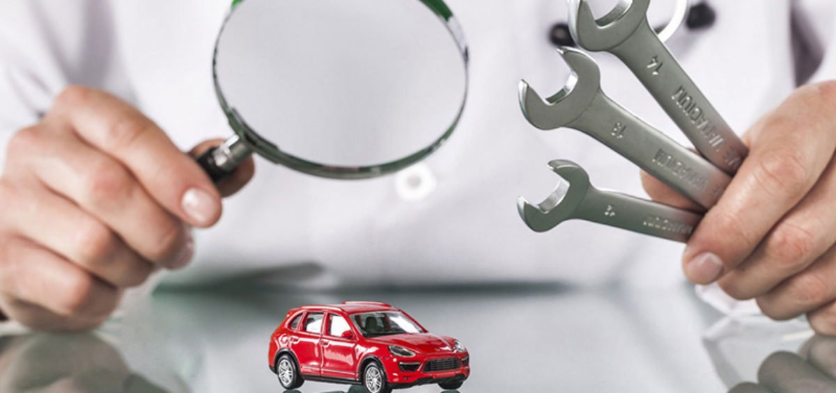 a red car under a magnifying glass